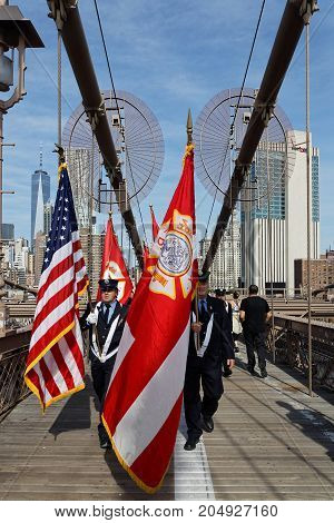 New York City, Usa, September 11, 2017 : Firemen Of New-york Walk On Brooklyn Bridge During Memorial