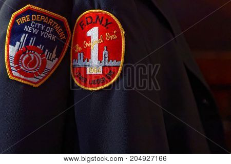 New York City, Usa, September 11, 2017 : Fire Department Of New-york Badges On A Fireman Uniform Dur