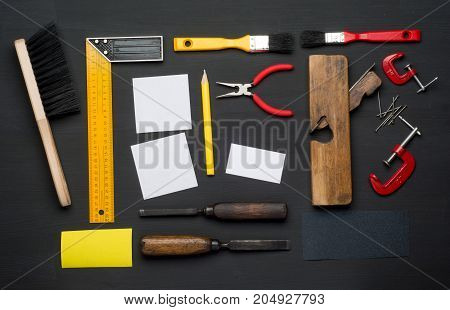 Top View of Assorted Woodwork and Carpentry Tools on Pine Wood Texture Background .