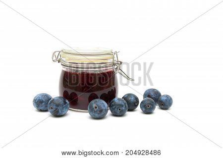 plum and plum jam isolated on white background. Horizontal photo.
