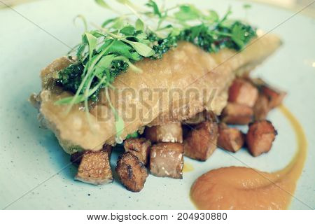 Gourmet battered fish with fried sweet potatoes - filter applied