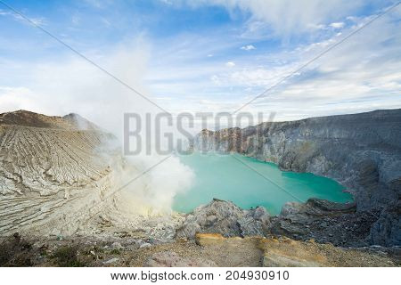 View of sunrise and Kawah Ijen volcano lake panorama in the Banyuwangi Regency of East Java Indonesia, Blue lake volcano.