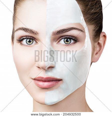 Half face of young woman with facial mask isolated on white. Spa concept.