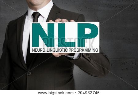 NLP sign is held by businessman picture