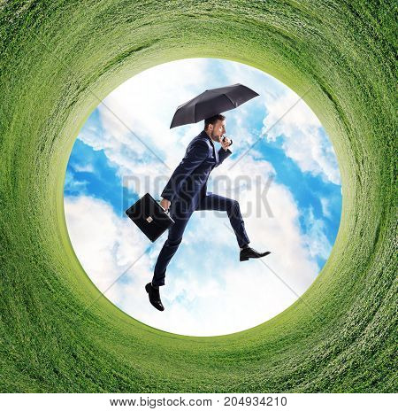 Businessman running into green grass circle. Global rush concept.