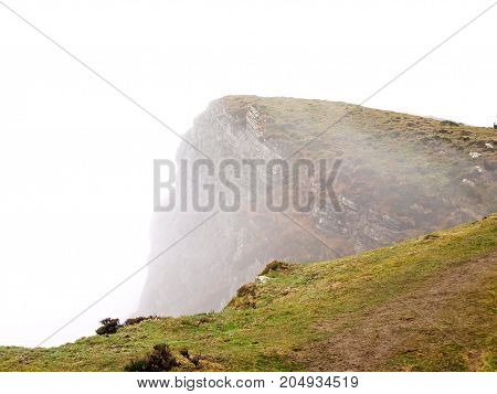 Top of the Ganekogorta mountain range with fog in autumn in Biscay Basque Country/Euskadi