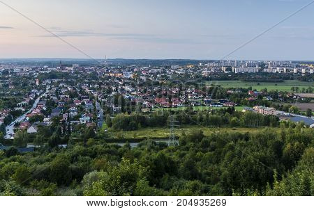 Differentiated city landscape in europe in the evening. View on the estate of single family homes and multifamily residential.