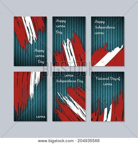 Latvia Patriotic Cards For National Day. Expressive Brush Stroke In National Flag Colors On Dark Str