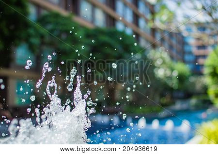 Freeze Splashing Droplets Of Water In The Air Near The Swimming Pool