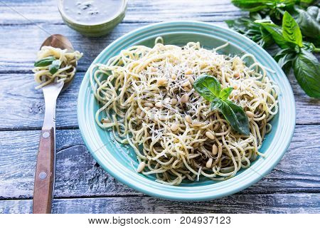 Pasta Spaghetti With Homemade Pesto Sauce And Basil Leafs, Wood Background