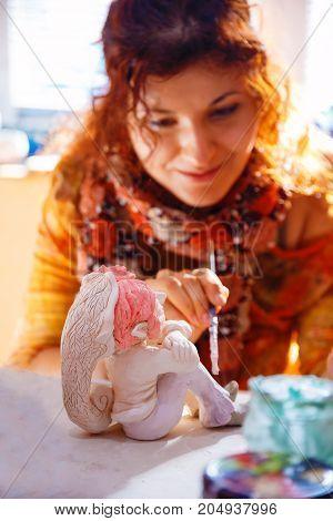yong Woman making a dwarf figure. Creative concept