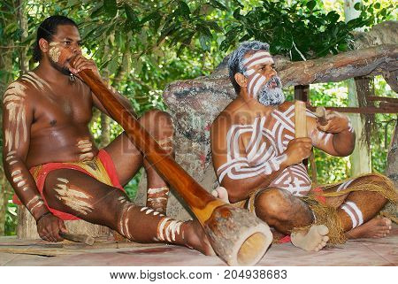 KURANDA, AUSTRALIA - NOVEMBER 07, 2007: Unidentified aborigine actors perform music with traditional instruments in the Tjapukai Culture Park in Kuranda, Queensland, Australia.