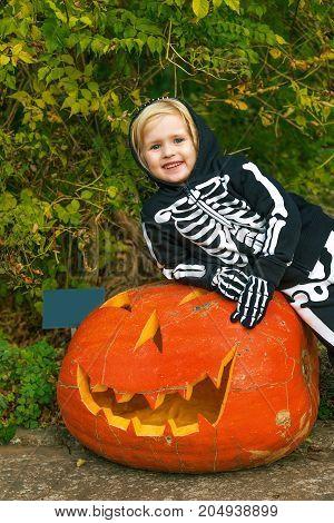 Smiling Girl With Huge Halloween Pumpkin Jack O'lantern