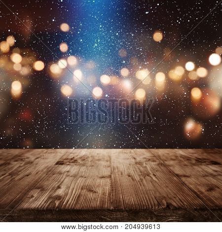 Christmas background with golden bokeh and blue light spot for a decoration
