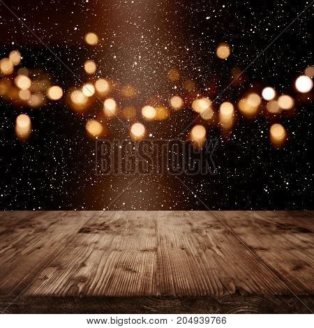 Background with golden bokeh and light beam for a christmas presentation