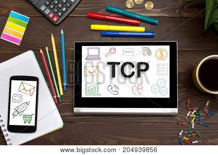 TCP Transmission Control Protocol the inscription on the touch-screen tablet on the table of a businessman
