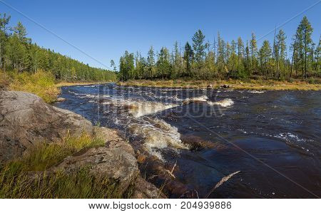 threshold on the Gorbylakh River in South Yakutia. Russia in the summer