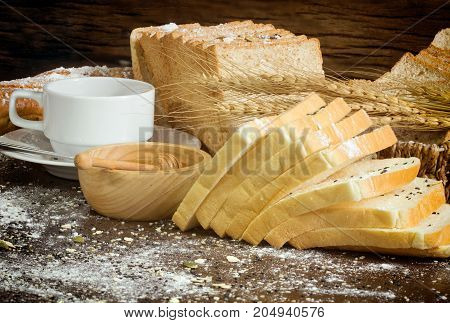 Variety Of Homemade Bread And Coffee On Wooden Table