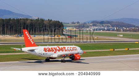Kloten, Switzerland - 28 March, 2017: Airbus A319-111 of EasyJet taxiing at the Zurich airport. EasyJet (styled as easyJet) is a British airline operating under the low-cost carrier model, based at London Luton Airport.