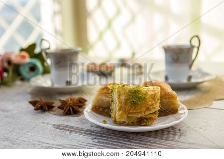Cups Of Turkish Coffee And A Plate With Baklava