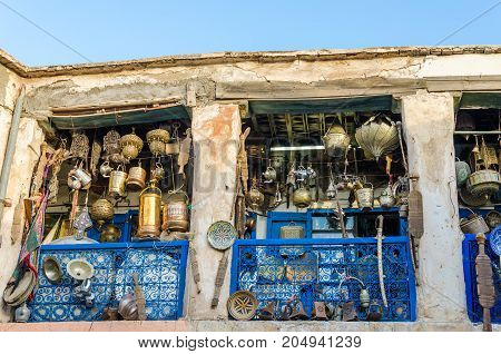 Huge selection of pots, lamps, lantern and other metal works in shop of souk in medina of Fez, Morocco, North Africa.