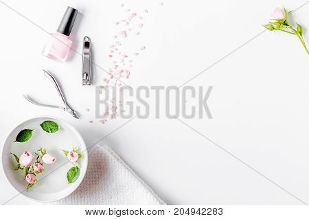 salt and cream for nail care in spa on white background top view
