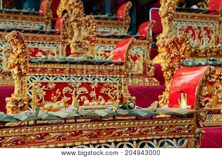 Traditional Balinese orchestra Gamelan - metallophones brass gongs and other musical percussion instruments. Arts music and culture of Bali island and Indonesian people. Asian travel background.