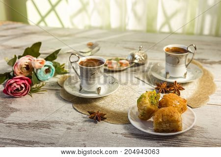 Two Cups Of Turkish Coffee And A Plate With Baklava