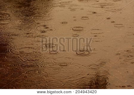 Abstract blur background of raining flow down on the floor brown tone.