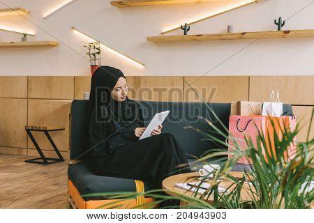 Muslim Woman Using Tablet