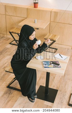 Muslim Woman Drinking Coffee