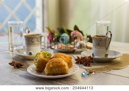 Two Cups Of Turkish Coffee And Plate With Baklava