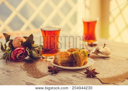 Two Traditional Glasses Of Turkish Tea And Baklava