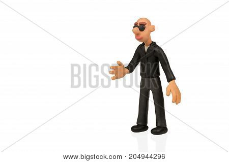 Plasticine bald gangster wearing glasses ready to shake hands isolated on white background