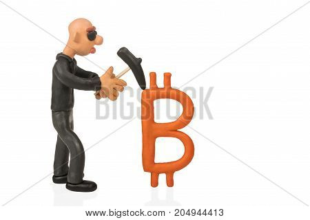 Bald plasticine businessman with glasses picket mines bitcoins isolated on white background