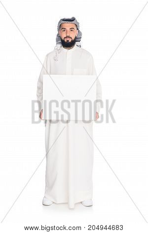 handsome muslim man holding blank board isolated on white