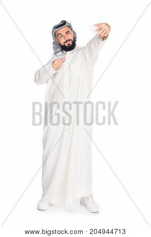 happy young muslim man taking selfie isolated on white