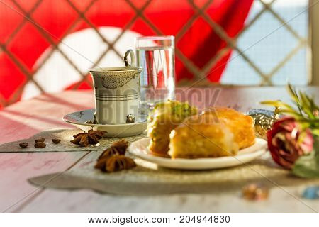 Cup Of Turkish Coffee And A Plate With Baklava And Turkish Flag On Background