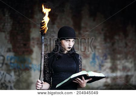 Woman Warlock with a torch and a book