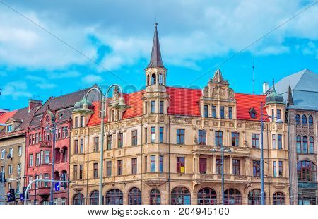 Wroclaw/Poland- August 17, 2017: Cityscape of old town, view of Swidnicka street with historic buildings and street lights on a summer day, blue sky