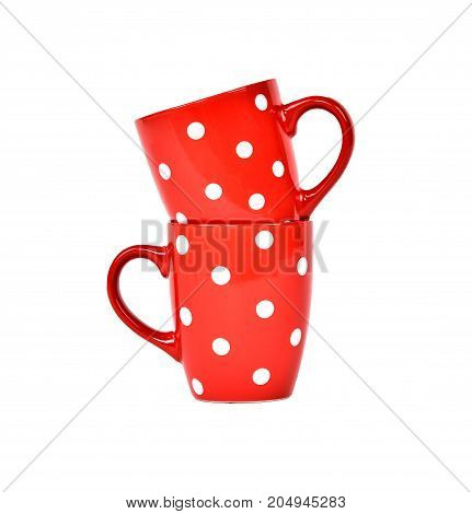 Isolated two red cups on white background.Kitchen utensils.Chinks for tea.