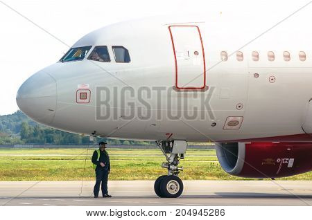 Technicians Checking Jet Engine Of Civil Passanger Airplane. Russia, Saint-petersburg August 10, 201