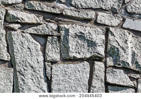 Stone texture. Abstract background of old cobblestone pavement close-up