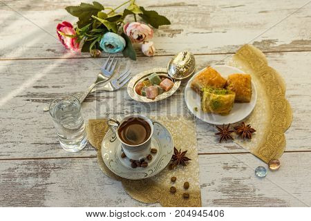 Cup Of Turkish Coffee And A Plate With Baklava Top View