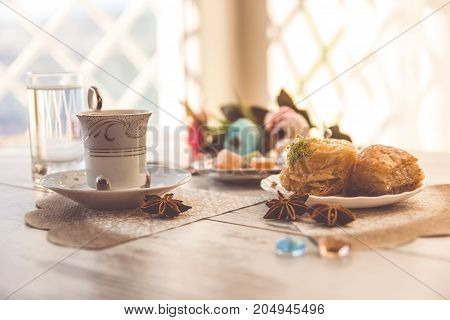 Cup Of Turkish Coffee And A Plate With Baklava