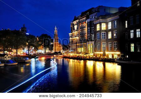 Amsterdam Holland Europe - scenic view of a canal and buildings at night
