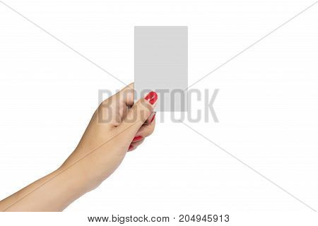 Woman hand with red nail hold blank business card mock up for copy space isolate on white background with clipping path
