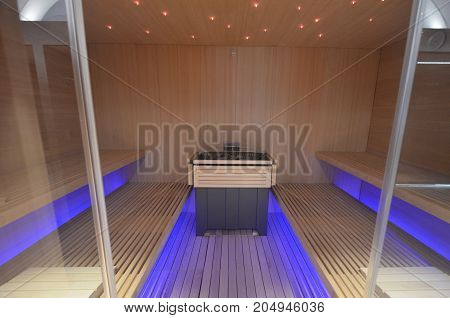 SPA interior sauna flooring walls and ceiling of wooden boards with illumination