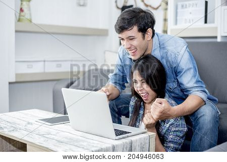 Lover are surprising when using the laptop. Family concept Lovers concept Technology concept