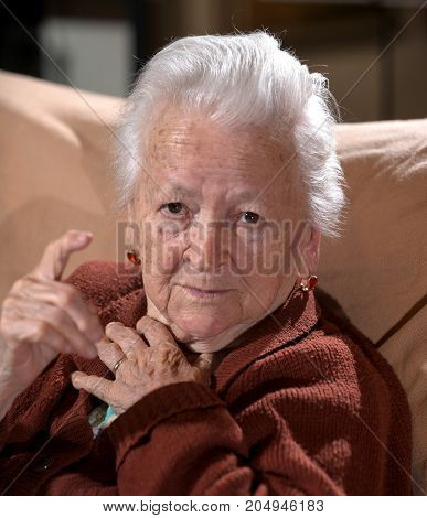 Old  Gray-haired Woman In Angry Gesture